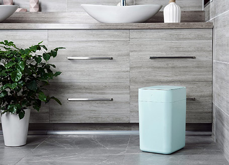 Bathroom with teal Townew trash can